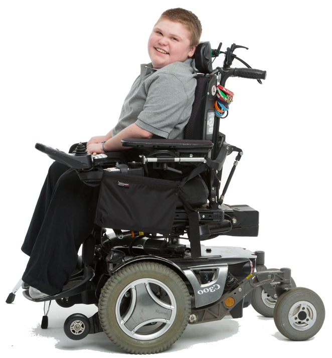 Boy in motorized wheelchair